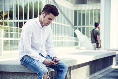 Young Man Listening to Music Using Earphones in City Royalty Free Stock Photos