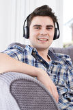 Young Man Listening To Music On Wireless Headphones Royalty Free Stock Photography
