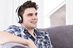 Young Man Listening To Music On Wireless Headphones Stock Photos