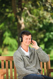 Young man listening to some music Stock Photos
