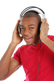 Young man listenning to music on headphones Stock Images