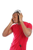 Young man listenning to music on headphones Stock Photos