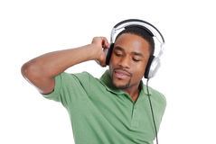 Young man listenning to music on headphones Royalty Free Stock Image