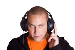 The young man listens to music Stock Photography