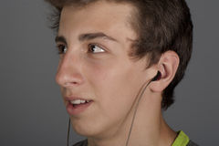Young man listens to music Stock Photography