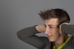 Young man listens to music Stock Photos