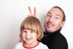 Young man with little blond Caucasian girl, studio portrait Royalty Free Stock Images
