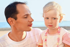 Young man with little girl on beach Stock Images
