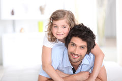 Young man with little girl on his back Stock Photos