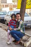 Young man, and little girl, posing for photographer, Kashan, Ira. Kashan, Iran - April 27, 2017: A little girl in sunglasses, and a young man, her father, posing Royalty Free Stock Photography