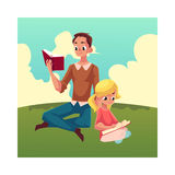 Young man and little girl reading books sitting legs crossed Royalty Free Stock Image