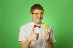 Young man with a lollipop Royalty Free Stock Images
