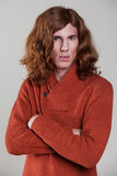 Young man with the long, auburn hair Royalty Free Stock Photography