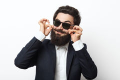 Young man with long beard and mustaches. Smiling at the camera on white background. Male magician stock photography
