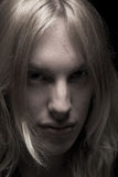 Young man with long blond hair Royalty Free Stock Image