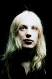 Young man with long blond hair royalty free stock photography