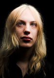 Young man with long blond hair royalty free stock photos