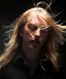 Young man with long blond hair Stock Photo