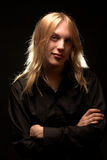 Young man with long blond hair Stock Image