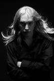 Young man with long blond hair Stock Images