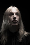Young man with long blond hair Stock Photography