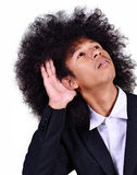 Young man with long hair listening Stock Photography