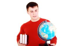 Young man look at globe. Stock Photography