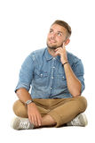 Young man look up thinking while sitting on the floor,  Stock Photography