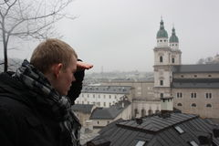 Young man looking above Salzburg town. Royalty Free Stock Photo