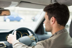 Young man looking ahead while driving Royalty Free Stock Images