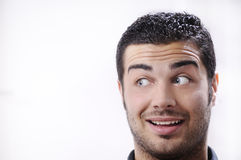 Young man looking with amazement and surprise Stock Photography