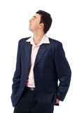 Young Man Looking Away. Portrait of a young man standing and looking away against white background Royalty Free Stock Images