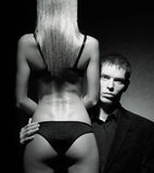 A young man looking from the back of a sexy woman Stock Photos
