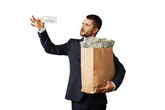 Young man looking at banknote Royalty Free Stock Image