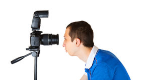 Young man looking into the camera lens Stock Photos