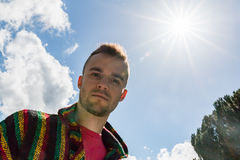 Young Man Looking at Camera With the Sunlight Overhead Stock Image