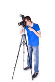 Young man looking into the camera on a tripod Stock Images