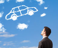 young man looking at car cloud on a blue sky Royalty Free Stock Photos