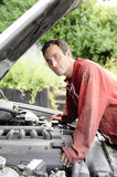 Young man  looking at the car engine Royalty Free Stock Image