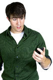 Young man looking at cell phone Royalty Free Stock Photos