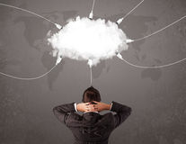 Young man looking at cloud transfer world service Royalty Free Stock Photo
