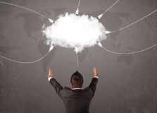 Young man looking at cloud transfer world service Royalty Free Stock Image