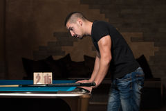 Young Man Looking Confused At Billiard Table Stock Image