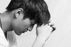 Young man looking depressed Royalty Free Stock Image