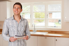 Young Man Looking At Details For New Home Royalty Free Stock Photos