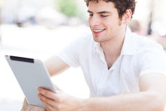 Young man looking at digital tablet Stock Images