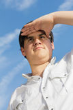 Young man looking into the distance Royalty Free Stock Image
