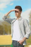 Young man looking into the distance Royalty Free Stock Photography