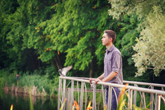 Young man looking into the distance on the nature Stock Photography