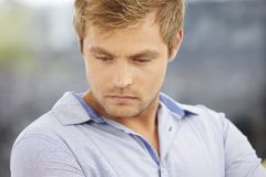 Young man looking down Stock Photography